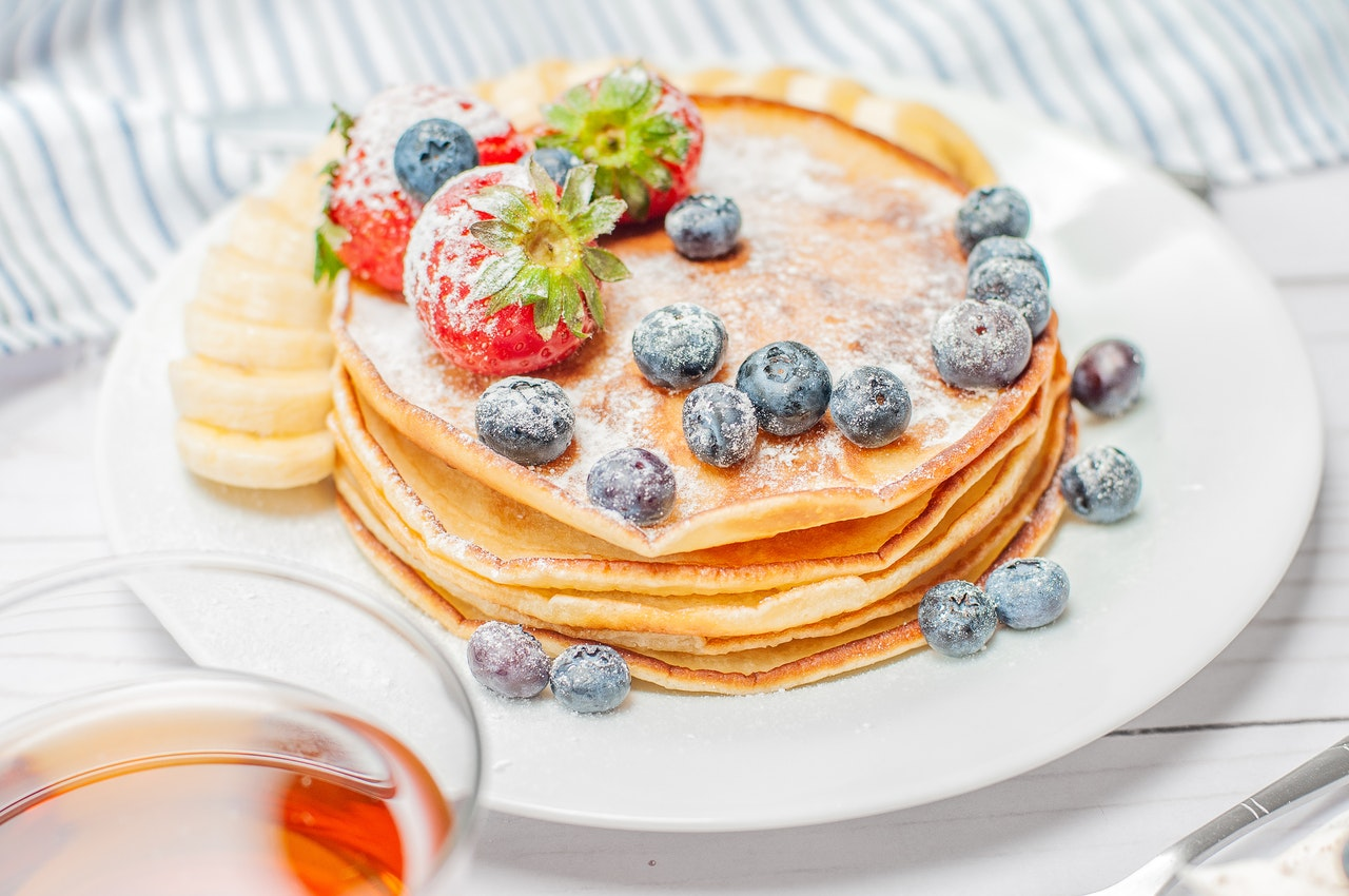 pancakes-with-berries-on-white-plate-2732663